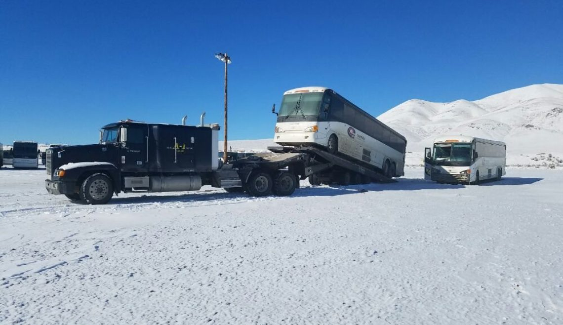 Hauling Bus on Traveling Axle Trailer