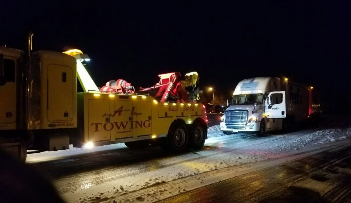 Snowy Nighttime Fed Ex Truck Recovery